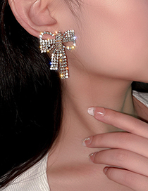 Fashion Golden Zircon Alloy Hollow Earrings With Bow And Diamonds