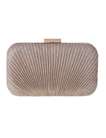 Fashion Champagne Hand Holding A Hard Shell Pleat Pack