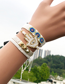 Fashion White Suit Woven Rice Beads Palm Eye Bracelet
