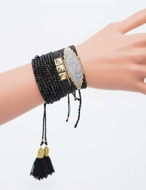 Black Rice Beads Woven Eye Tassel Bracelet