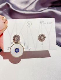 Fashion Real Gold Plated Asymmetrical Shell Copper Inlaid Zircon Eye Earrings