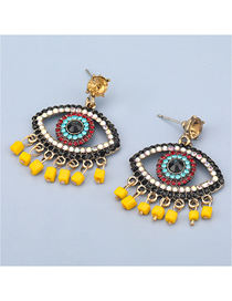 Fashion Yellow Alloy Diamond Eyes Resin Tassel Earrings