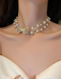 Fashion Golden Bow Pearl Necklace